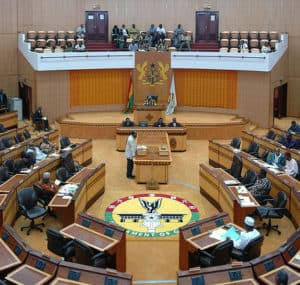 Lawmakers meet during a parliament session in Ghana